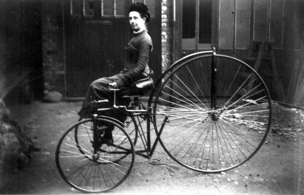 Miss Clara Hayball, (Mrs. Keeling), on a velocipede, taken by her father, Arthur Hayball at his wood-carving works on Cavendish Street